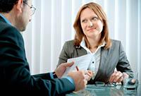 Man and Woman Conducting a Job Interview - Peter Barron Stark Companies