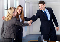 A business woman introducing another woman to a business man - negotiation - Peter Barron Stark Companies