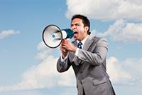 Man Yelling into microphone - Peter Barron Stark